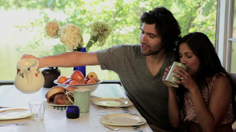 Girl and parents having breakfast together outdoors Stock Video Footage