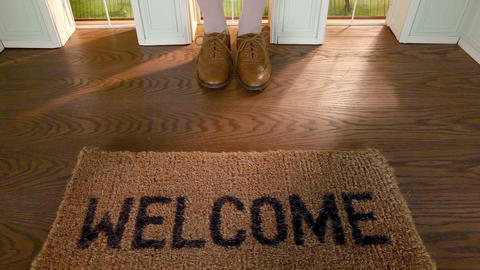 Legs of woman stepping on welcome mat Stock Video Footage