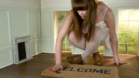 Young woman in small house with key and welcome mat Stock Video Footage