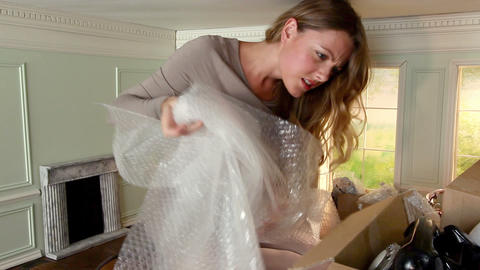 Young woman get frustrated at packing box of objects in... Stock Video Footage