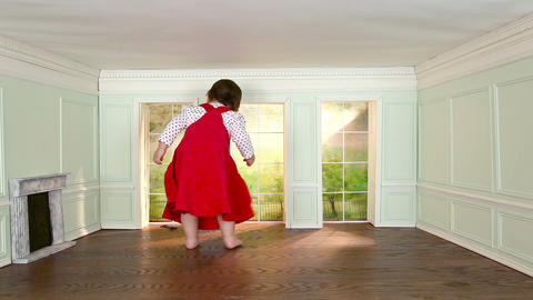Giant toddler girl in tiny room, looking through window Stock Video Footage