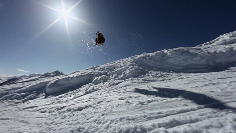 Man doing jump on snowboard in ski resort Stock Video Footage