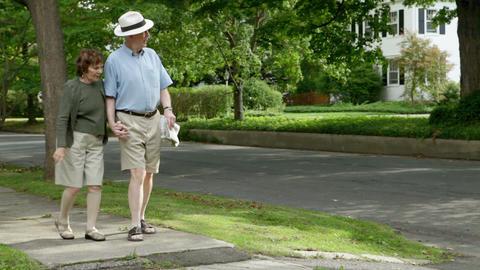 Senior couple walking in neighborhood Stock Video Footage