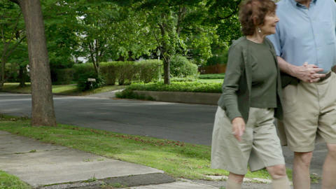 Senior couple walking in neighborhood Stock Video Footage