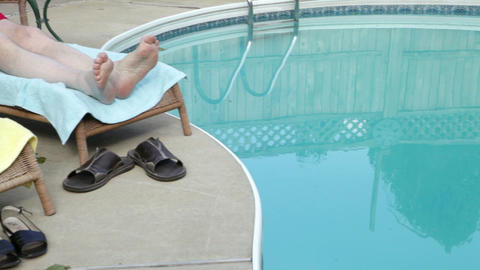 Senior couple relaxing by pool Stock Video Footage