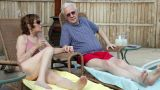 Senior couple relaxing by pool Footage