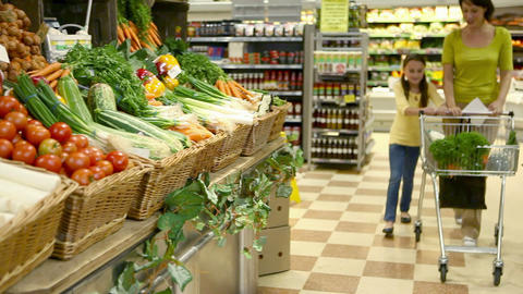 Mother and children in fruit and vegetable section of... Stock Video Footage