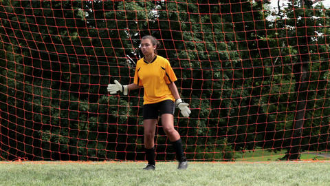 Girl goalkeeper making a save Stock Video Footage