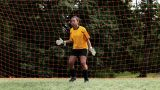 Girl goalkeeper making a save Footage