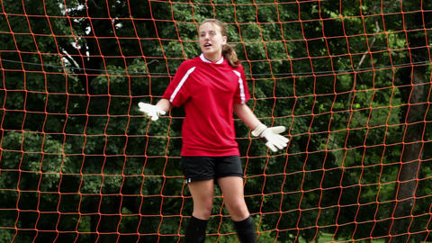 Girl goalkeeper being hit by ball Stock Video Footage