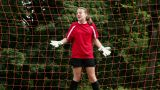 Girl goalkeeper being hit by ball Footage