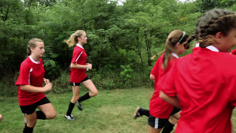 Girl soccer players running Stock Video Footage