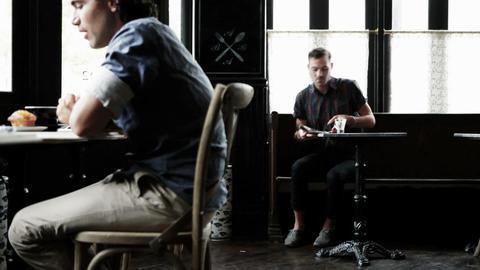 Men in coffee shop Stock Video Footage