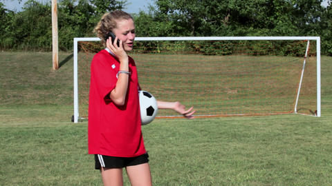 Girl soccer player with cellphone Stock Video Footage