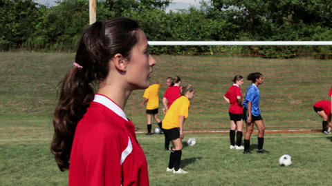 Girl soccer player heading the ball Stock Video Footage