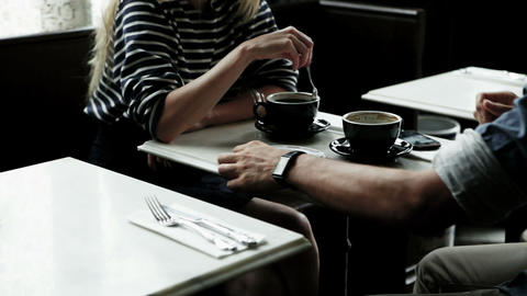 Couple having coffee, man pays bill Stock Video Footage