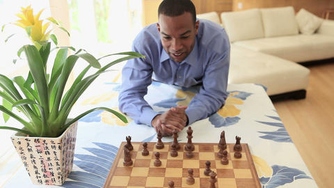 Young man playing chess Stock Video Footage