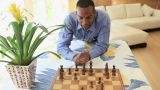 Young man playing chess Footage