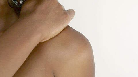 Woman rubbing aching shoulder Stock Video Footage