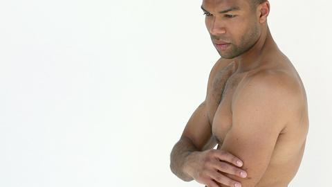 Man rubbing aching arm Stock Video Footage