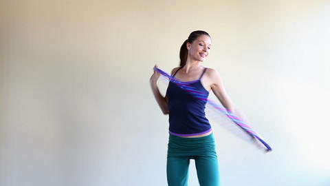 Woman doing pilates with plastic hoop Stock Video Footage