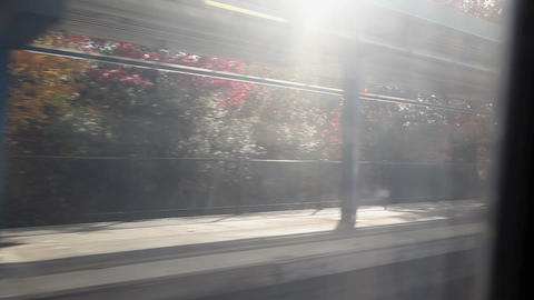 View from train as it passes train station platform Stock Video Footage