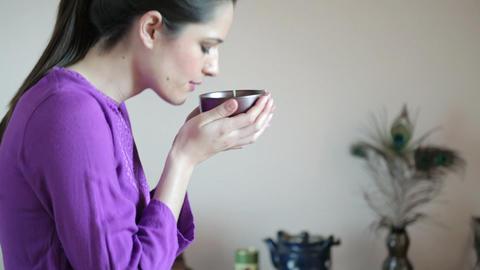 Women sitting cross legged drinking herbal tea Stock Video Footage