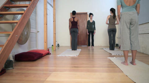 Women doing yoga class with instructor Stock Video Footage