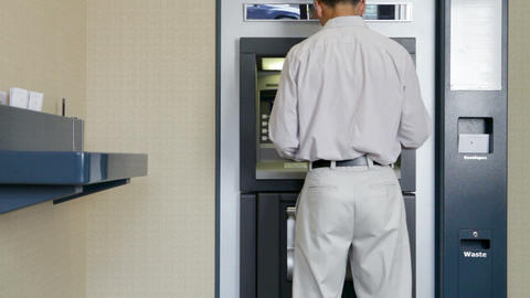 Man withdrawing money from cash machine Stock Video Footage