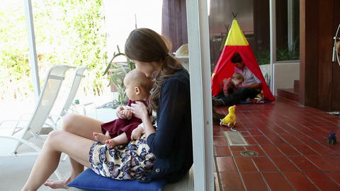 Family at home, mother holding baby boy Stock Video Footage