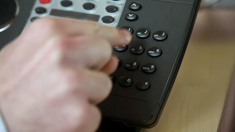 Office worker dialling on a landline phone Stock Video Footage