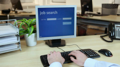 Office worker using computer to perform job search Footage