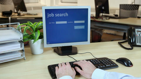 Office worker using computer to perform job search Stock Video Footage