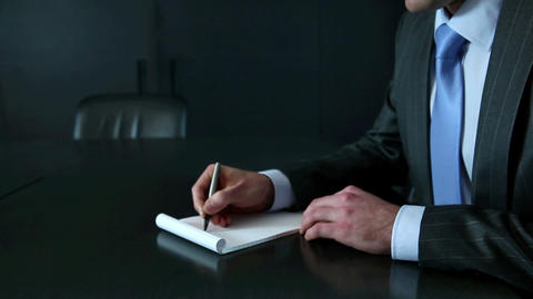 Businessman making notes in notebook Stock Video Footage