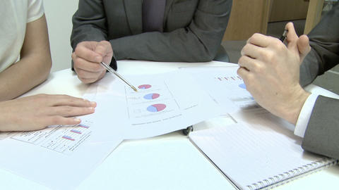 Businesspeople explaining pie charts Stock Video Footage