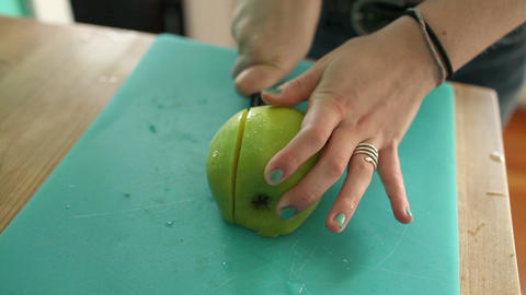 Teenage girl slicing apple Stock Video Footage