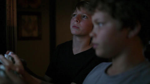 Two boys playing video games Stock Video Footage