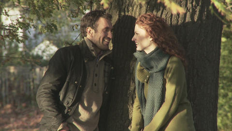 Happy couple by a tree Stock Video Footage