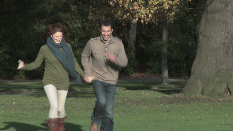 Couple running in park Stock Video Footage