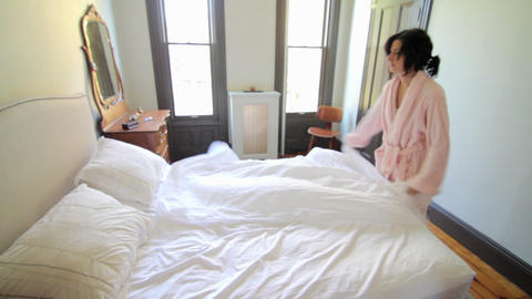 Woman making bed Stock Video Footage