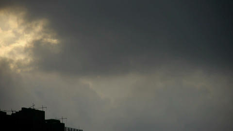 Clouds cover sun sky,building high-rise,House silhouette Footage