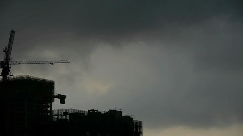Dark clouds cover sun sky,building high-rise,House silhouette Footage