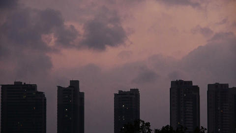 Dark clouds cover sky at evening,building high-rise,House silhouette Footage