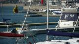 Yacht on the water at Pier of QingDao city Olympic Sailing Center,tsingtao,dam Footage
