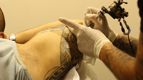 Tattoo shop tattooing pain artists body art skin needle draw sterile hiv pain Footage