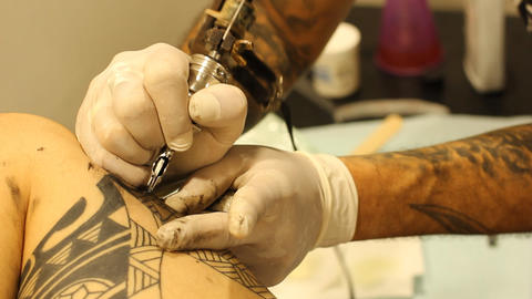 Tattoo shop tattooing pain artists body art skin needle... Stock Video Footage