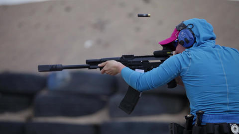 girl and Kalashnikov Stock Video Footage