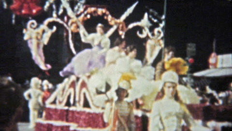1959: College parade floats of Texas, SMU, ASU university cowgirls dancing with  Footage