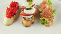 bruschetta with tomato, mozzarella and salmon Footage