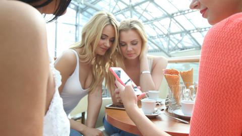 Women with smartphones at cafe Footage